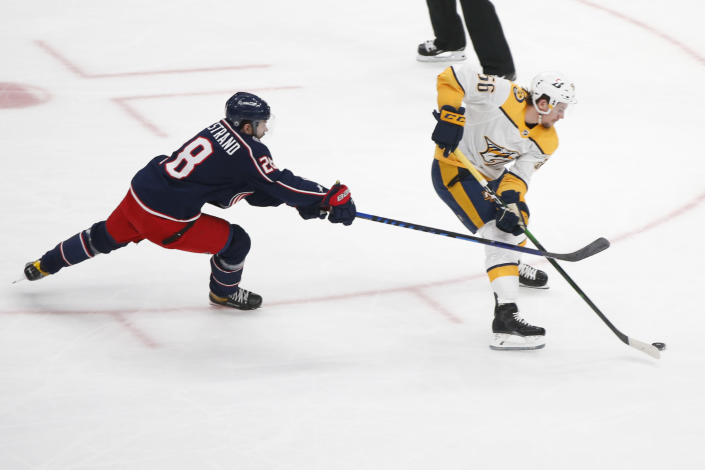 Columbus Blue Jackets Oliver Bjorkstrand, left, tries to stop Nashville Predators Erik Haula on a breakaway during the first period of an NHL hockey game Monday, May 3, 2021, in Columbus, Ohio. (AP Photo/Jay LaPrete)
