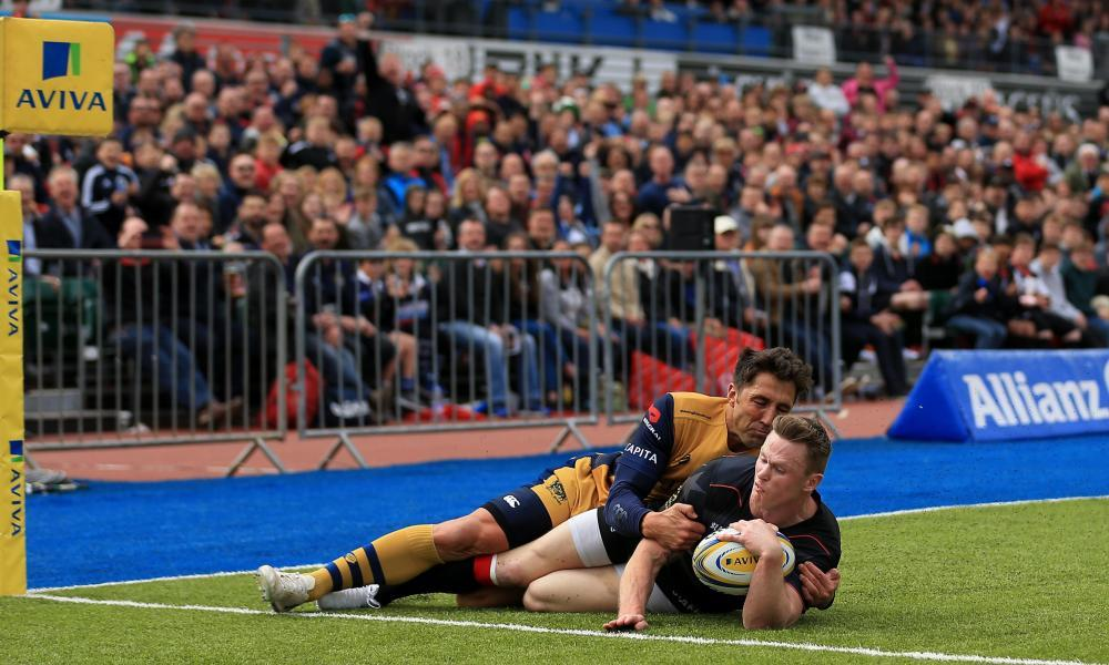 Saracens' Chris Ashton is tackled by Gavin Henson before having his try disallowed.