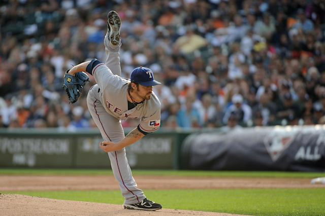 DETROIT, MI - OCTOBER 13: C.J. Wilson #36 of the Texas Rangers throws a pitch against the Detroit Tigers in the first inning of Game Five of the American League Championship Series at Comerica Park on October 13, 2011 in Detroit, Michigan. (Photo by Harry How/Getty Images)