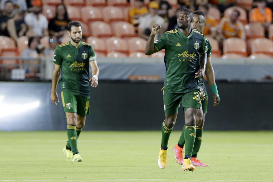 Portland Timbers' Diego Valeri, left, Dairon Asprilla, middle, and Jeremy Ebobisse, right, celebrate the goal by Asprilla during the second half of an MLS soccer match against the Houston Dynamo Wednesday, June 23, 2021, in Houston. (AP Photo/Michael Wyke)