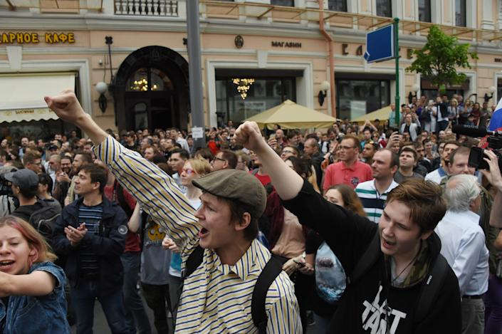 People chant slogans during an unauthorized opposition rally in Moscow.