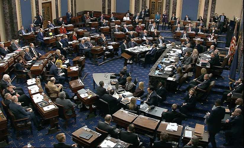 Senators vote on approving the rules for the impeachment trial against President Donald Trump. AP