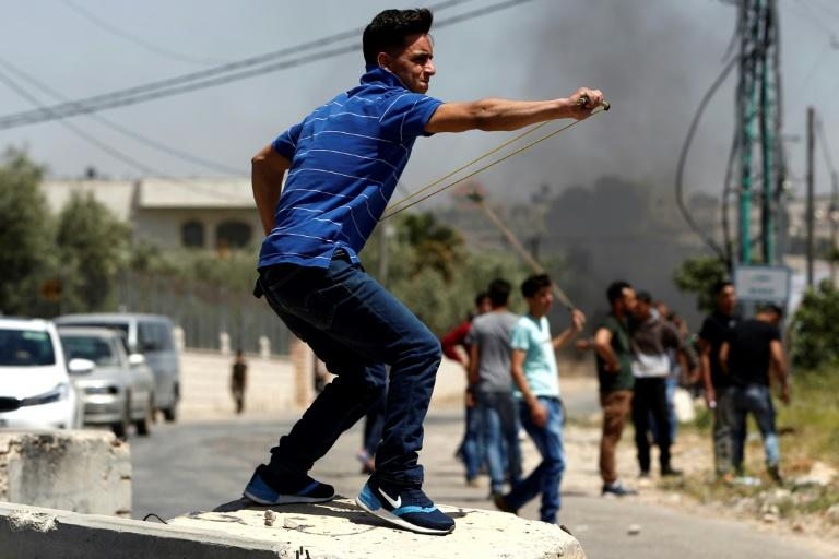 Palestinian protesters clash with Israeli soldiers in the occupied West Bank village of Silwad during a demonstration in support of hundreds of Palestinian prisoners on hunger strike in Israeli jails