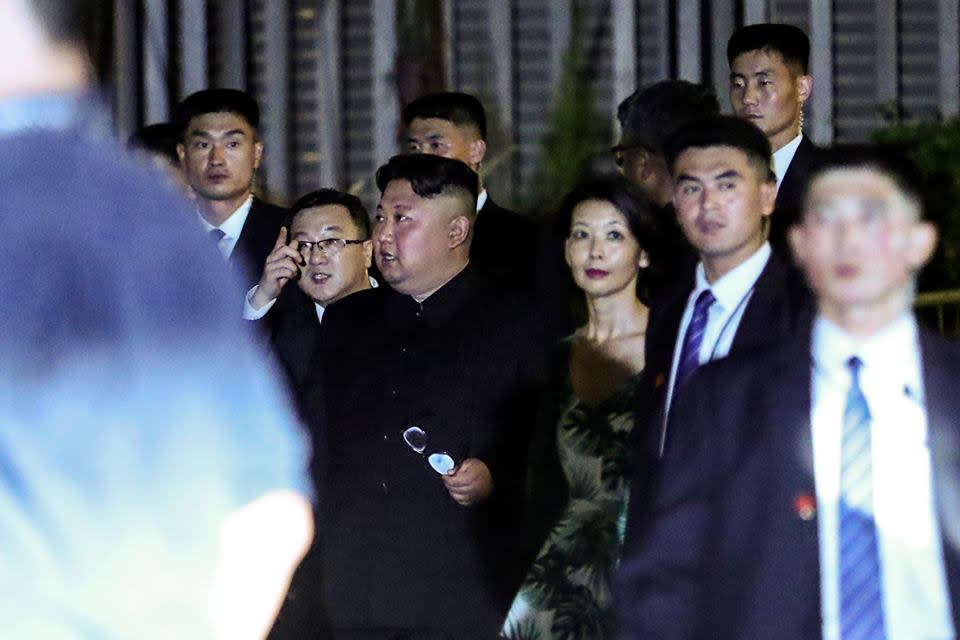 <p>North Korean leader Kim Jong Un (centre) seen with his entourage at the Marina Bay Sands on 11 June 2018. (PHOTO: AP) </p>