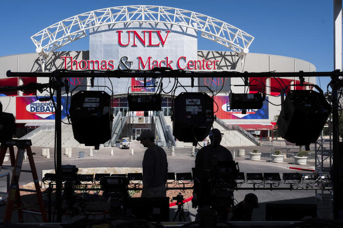 Television crews set up outside of the presidential debate site at the University of Nevada, Las Vegas on Oct. 17, 2016, as preparations continue for the final debate between Republican presidential nominee Donald Trump and Democratic presidential nominee Hillary Clinton. (Photo: J. David Ake/AP)