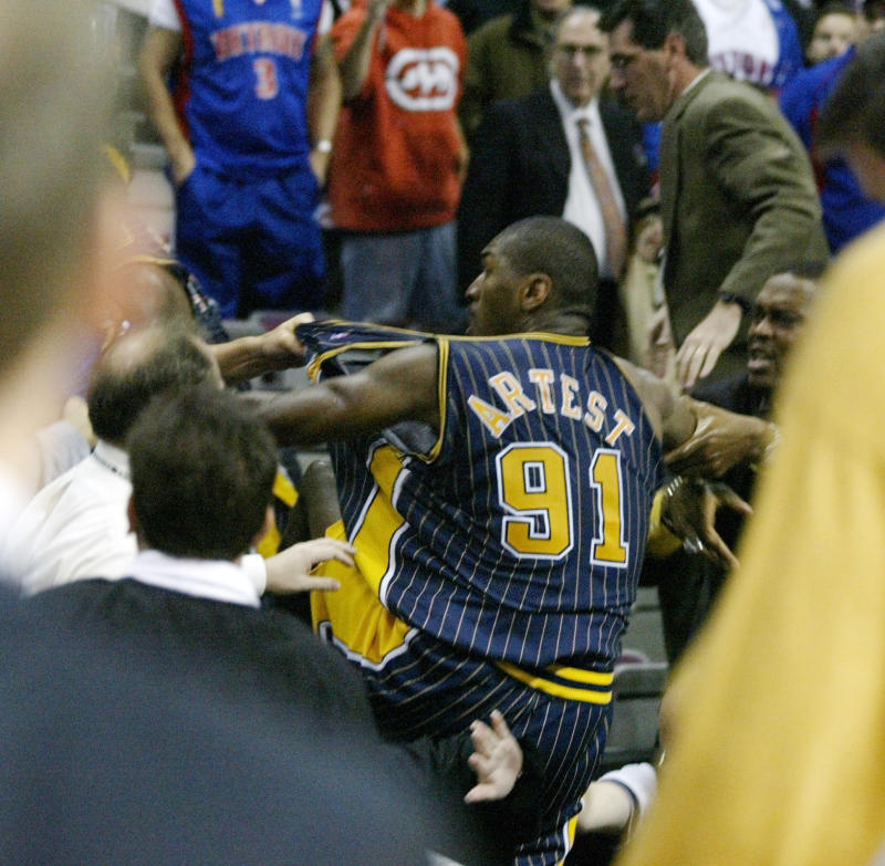 Indiana Pacers forward Ron Artest is grabbed by fans after he went into the seats during a a brawl with the Detroit Pistons with just 45.9 seconds left in the game on Nov. 19, 2004. (AP Photo/Duane Burleson)