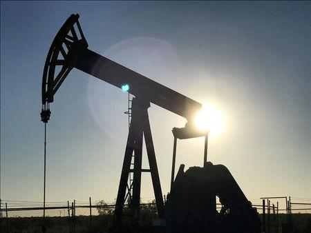 FILE PHOTO: An oil pump is seen operating in the Permian Basin near Midland