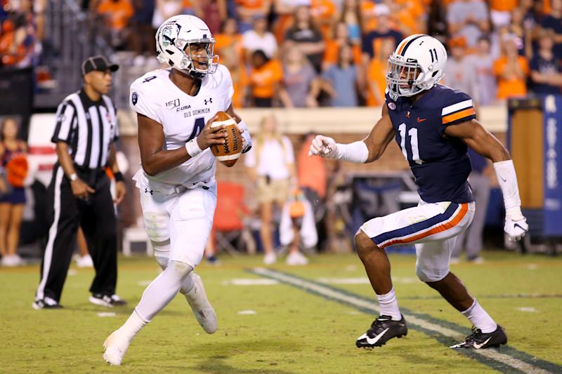 Virginia EDGE-LB Charles Snowden, right, had a brilliant game last week. (Getty Images)