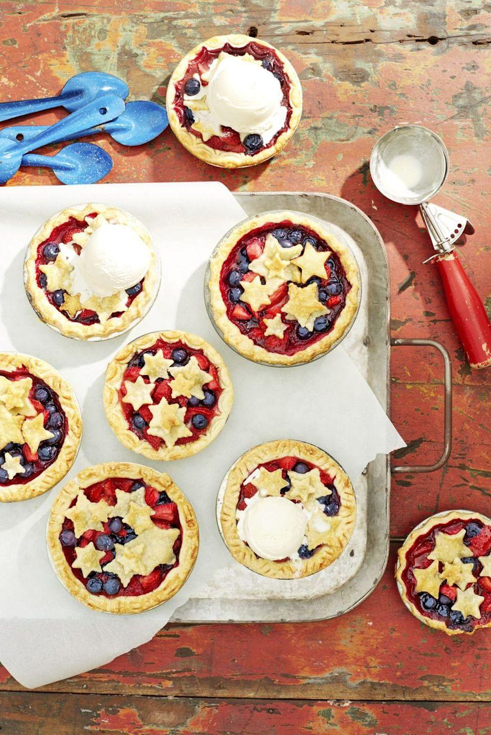 """<p>Personal-sized berry pies are a perfect Memorial Day recipe. A scoop of <a href=""""https://www.countryliving.com/food-drinks/recipes/a3404/vanilla-ice-cream-recipe-clv0610/"""" rel=""""nofollow noopener"""" target=""""_blank"""" data-ylk=""""slk:homemade vanilla ice cream"""" class=""""link rapid-noclick-resp"""">homemade vanilla ice cream</a> makes them especially irresistible. </p><p><strong><a href=""""https://www.countryliving.com/food-drinks/a21348015/mini-stars-berry-pies-recipe/"""" rel=""""nofollow noopener"""" target=""""_blank"""" data-ylk=""""slk:Get the recipe"""" class=""""link rapid-noclick-resp"""">Get the recipe</a>.</strong></p>"""