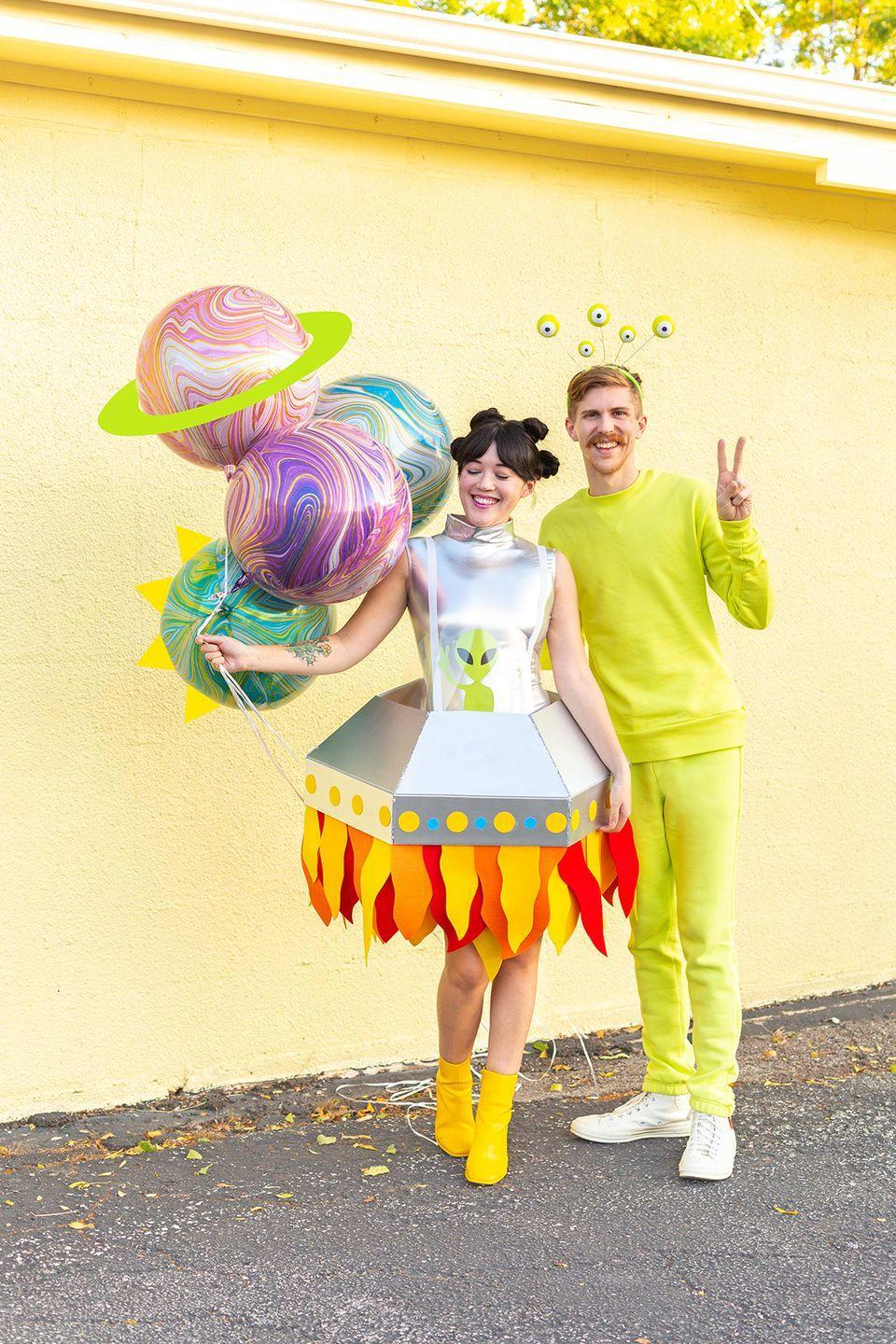 "<p>To make the alien portion of this costume, all you need is a neon sweatsuit and a matching alien headband. Extra points for carrying a bouquet of planet balloons.</p><p><em><a href=""http://www.awwsam.com/2019/10/ufo-and-alien-couples-costume.html"" rel=""nofollow noopener"" target=""_blank"" data-ylk=""slk:Get the tutorial at Aww Sam »"" class=""link rapid-noclick-resp"">Get the tutorial at Aww Sam »</a></em></p><p><strong>RELATED: </strong><a href=""https://www.goodhousekeeping.com/holidays/halloween-ideas/g2625/halloween-costumes-for-couples/"" rel=""nofollow noopener"" target=""_blank"" data-ylk=""slk:80 Best Couples Halloween Costumes for Creative Duos"" class=""link rapid-noclick-resp"">80 Best Couples Halloween Costumes for Creative Duos</a></p>"
