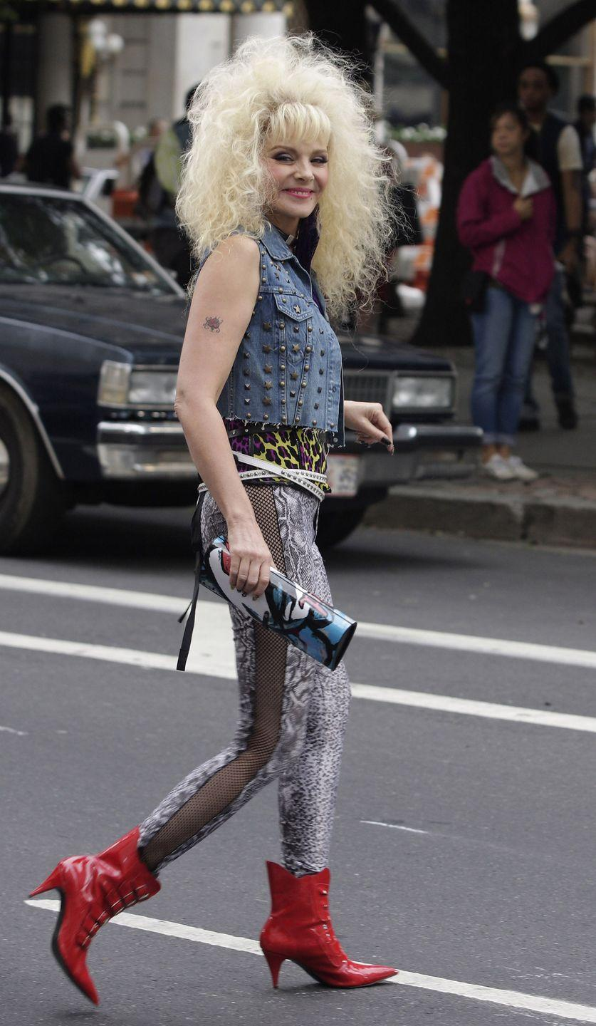 <p>For <em>Sex and the City 2,</em> Kim Catrall dressed in an '80s-inspired denim vest that is hard to forget. Perhaps that's because it's paired with a leopard leotard, snakeskin leggings, and red leather boots. </p>