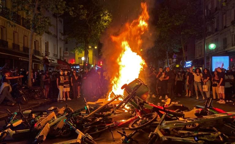 Following a protest against police violence, demonstrators set up a burning barricade in Paris