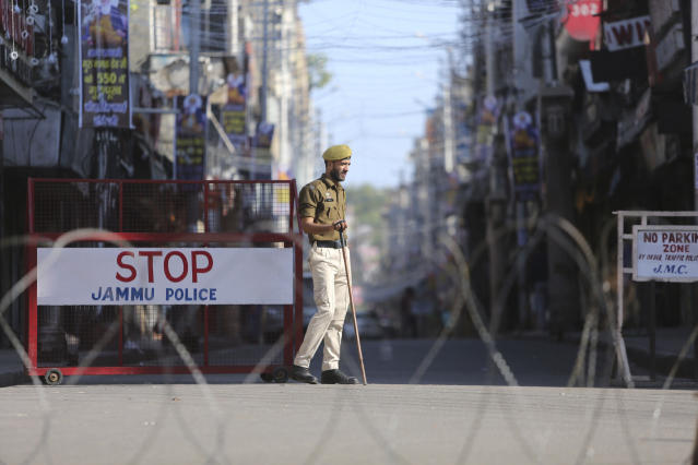 An Indian policeman stands guard in Jammu, India, Saturday, Nov. 9, 2019. State-run broadcaster says India's top court has ruled for a disputed temple-mosque land for Hindus with alternate land to Muslims. The Supreme Court says in a judgment on Saturday that 5 acres (2.02 hecatres) of land be allotted to the Muslim community represented by the Sunni Central Wakf Board in the northern Indian town of Ayodhya where a 16th century mosque was demolished by Hindu hardliners in 1992. (AP Photo/Channi Anand)