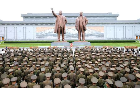 Servicepersons of the Korean People's Army (KPA) and the Korean People's Internal Security Forces (KPISF), civilians, school youth and children visited the statues of President Kim Il Sung and leader Kim Jong Il on the occasion of the 72nd anniversary of national liberation in this undated photo released by North Korea's Korean Central News Agency (KCNA) on August 15, 2017. KCNA/via REUTERS