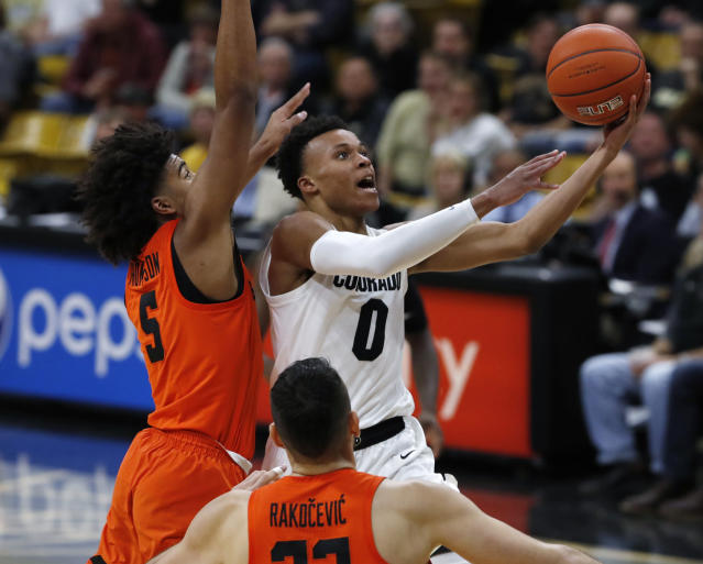 Colorado guard Shane Gatling (8) drives to the rim past Oregon State guard Ethan Thompson in the second half of an NCAA college basketball game Thursday, Jan. 31, 2019, in Boulder, Colo. (AP Photo/David Zalubowski)