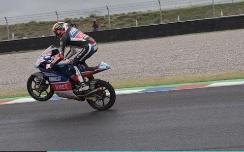 Marco Bezzecchi does a wheelie at the end of the Moto3 in Argentina - Credit: Getty Images South America/Mirco Lazzari gp
