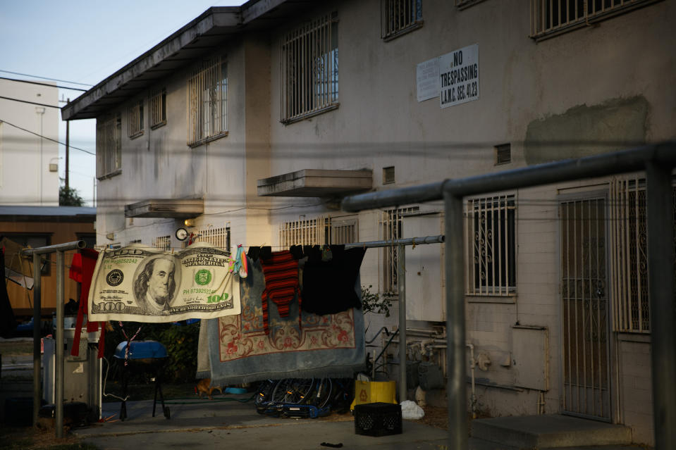 Laundry hangs on a clothesline outside an apartment building at the Jordan Downs housing project in the Watts neighborhood of Los Angeles, Monday, June 15, 2020. (AP Photo/Jae C. Hong)