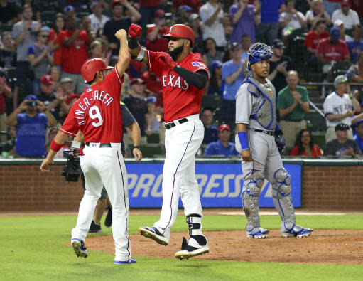 Texas Rangers' Isiah Kiner-Falefa (9) celebrates the fifth-inning home run by Nomar Mazara (30) against the Kansas City Royals in a baseball game Friday, May 25, 2018, in Arlington, Texas. (AP Photo/Richard W. Rodriguez)