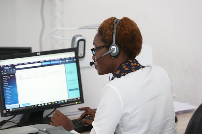 A free call can be made to the helpline round the clock every day. (AFP Photo/STEVE JORDAN)