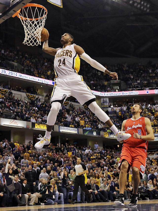 FILE - In this Jan. 18, 2014, file photo, Indiana Pacers forward Paul George (24) dunks in front of the Los Angeles Clippers Hedo Turkoglu (8) during the second half of an NBA basketball game in Indianapolis. Indiana's Paul George and Golden State's Stephen Curry could be first-time starters when the NBA announces the results of fan balloting for the All-Star game on Thursday, Jan. 23, 2013. (AP Photo/AJ Mast, File)