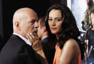 """Cast member Bruce Willis and his wife Emma Heming attend the premiere of """"G.I. Joe: Retaliation"""" in Hollywood, California March 28, 2013. The movie opens in the U.S. on March 28. REUTERS/Mario Anzuoni (UNITED STATES - Tags: ENTERTAINMENT)"""