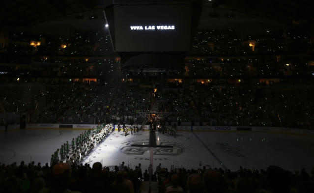 "The <a class=""link rapid-noclick-resp"" href=""/nhl/teams/dal/"" data-ylk=""slk:Dallas Stars"">Dallas Stars</a> and Vegas Golden Knights stood together to honour those who lost their lives in Sunday's horrific attack in Las Vegas. (AP Photo/LM Otero)"