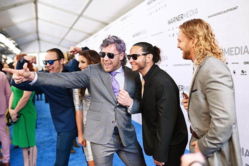 "NEW YORK, NEW YORK - MAY 15: Matt Jackson, Britt Baker, Kenny Omega, Nick Jackson and ""Hangman"" Adam Page of TNT's All Elite Wrestling attends the WarnerMedia Upfront 2019 arrivals on the red carpet at The Theater at Madison Square Garden on May 15, 2019 in New York City. 602140 (Photo by Mike Coppola/Getty Images for WarnerMedia)"