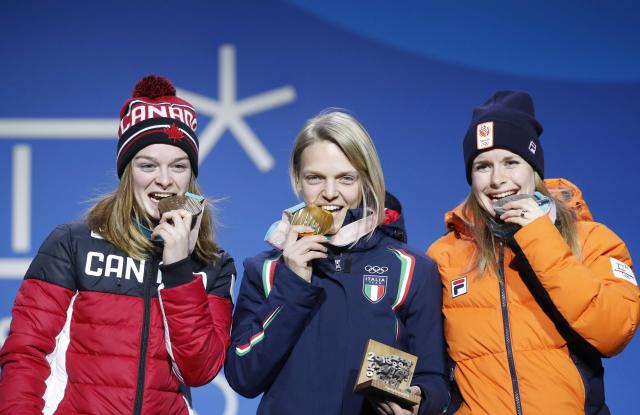 Medals Ceremony - Short Track Speed Skating Events - Pyeongchang 2018 Winter Olympics - Women's 500m - Medals Plaza - Pyeongchang, South Korea - February 14, 2018 - Gold medalist Arianna Fontana of Italy, silver medalist Yara van Kerkhof of the Netherlands and bronze medallst Kim Boutin of Canada on the podium. REUTERS/Kim Hong-Ji