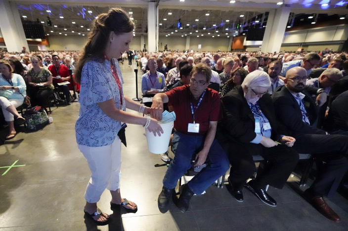 Votes are collected on the first ballot for president of the Southern Baptist Convention during the denomination's annual meeting Tuesday, June 15, 2021, in Nashville, Tenn. (AP Photo/Mark Humphrey)