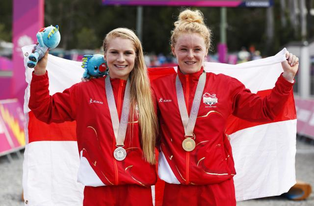 Cycling Cross-Country - Gold Coast 2018 Commonwealth Games - Mountain Bike - Women's Cross-Country - Nerang Mountain Bike Trails - Gold Coast, Australia - April 12, 2018. Gold medallist Annie Last of England and silver medallist Evie Richards of England pose with their medals. REUTERS/Paul Childs