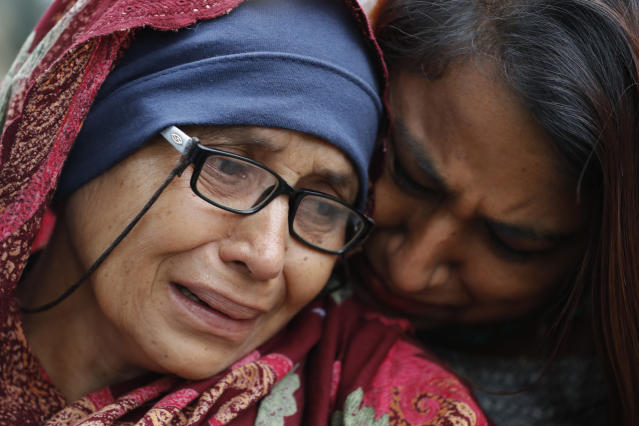 In this Saturday, March 16, 2019, file photo, a woman who lost her husband during Friday's mass shootings cries outside an information center for families, in Christchurch, New Zealand. (AP Photo/Vincent Thian, File)