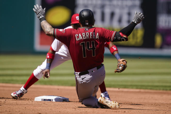 Arizona Diamondbacks' Asdrúbal Cabrera is out on the tag by Washington Nationals second baseman Starlin Castro trying to reach second on a single, during the third inning of a baseball game at Nationals Park, Sunday, April 18, 2021, in Washington. (AP Photo/Alex Brandon)