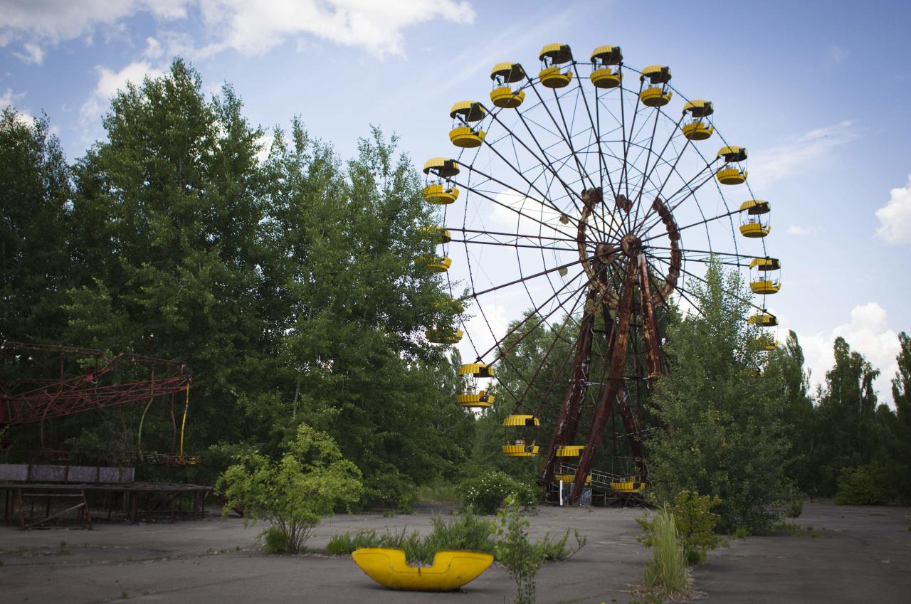 This June 8, 2011 photo shows a Ferris wheel at a playground in the deserted town of Pripyat, Ukraine, some 3 kilometers (1.86 miles) from the Chernobyl nuclear plant. Chernobyl and Fukushima are some 5,000 miles apart but have much in common. The towns nearest to each of these stricken nuclear power stations, in Ukraine and Japan, whose disasters struck 25 years apart, already reveal eerie similarities. (AP Photo/Sergey Ponomarev) ONE OF PAIR NO. 4