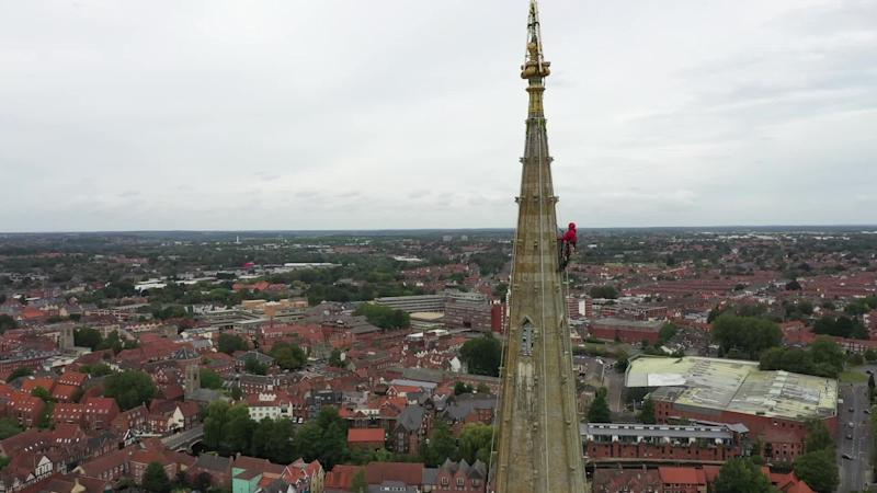Restoration experts climb Norwich Cathedral spire