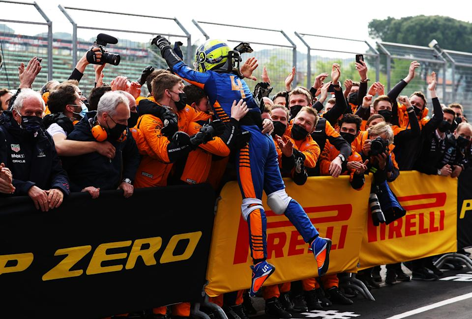IMOLA, ITALY - APRIL 18: Third placed Lando Norris of Great Britain and McLaren F1 celebrates in parc ferme with his team during the F1 Grand Prix of Emilia Romagna at Autodromo Enzo e Dino Ferrari on April 18, 2021 in Imola, Italy. (Photo by Bryn Lennon/Getty Images)