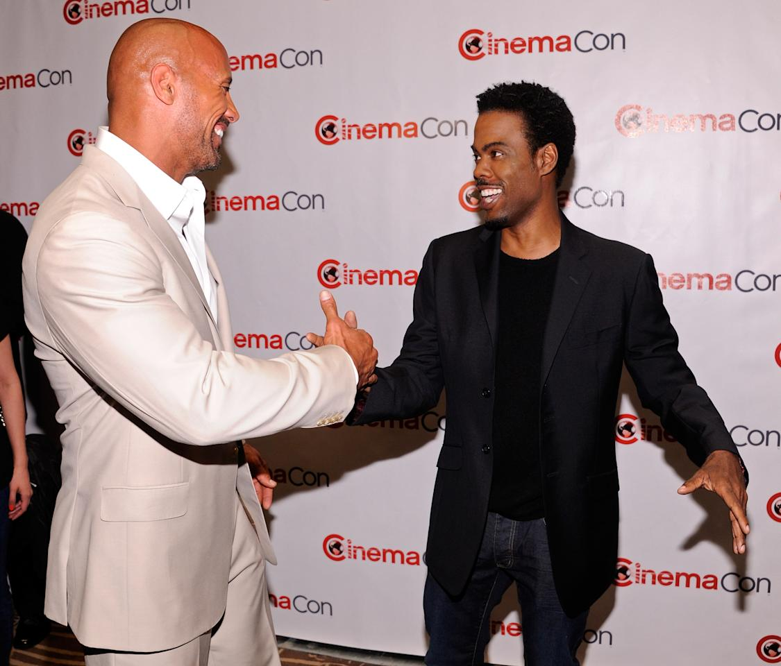 """LAS VEGAS, NV - APRIL 23:  Actor Dwayne Johnson (L) and actor/comedian Chris Rock arrive at a Paramount Pictures and DreamWorks Animation event at Caesars Palace during the opening night of CinemaCon, the official convention of the National Association of Theatre Owners, April 23, 2012 in Las Vegas, Nevada. Johnson is promoting his upcoming movie, """"G.I. Joe: Retaliation"""" and Rock is promoting his new animated film, """"Madagascar 3: Europe's Most Wanted.""""  (Photo by Ethan Miller/Getty Images)"""