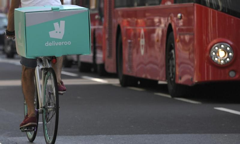 A cyclist delivers food for Deliveroo in London.