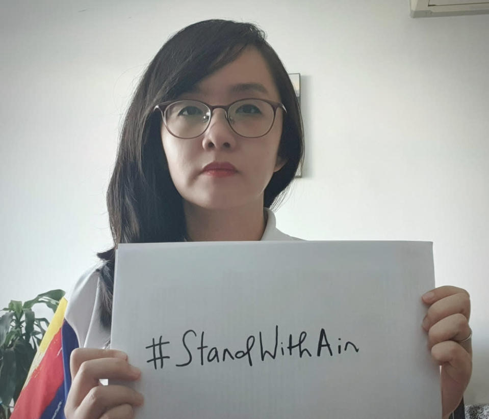 Subang Jaya assemblyman Michelle Ng poses with a '#StandWithAin' placard May 9, 2021. — Picture via Twitter/Michelle Ng