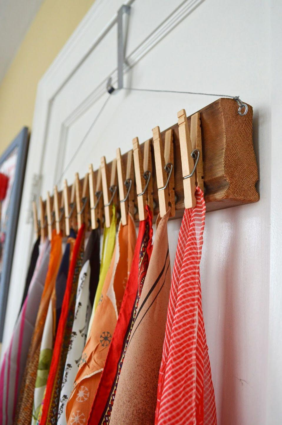 """<p>Who says clothespins are only for hanging things up to dry? They can keep your fabric accessories off the floor, too. </p><p><a href=""""http://www.sallyannk.com/2014/05/diy-clothes-pin-scarf-holder.html"""" rel=""""nofollow noopener"""" target=""""_blank"""" data-ylk=""""slk:See more at Sally Ann K »"""" class=""""link rapid-noclick-resp""""><em>See more at Sally Ann K »</em></a></p>"""