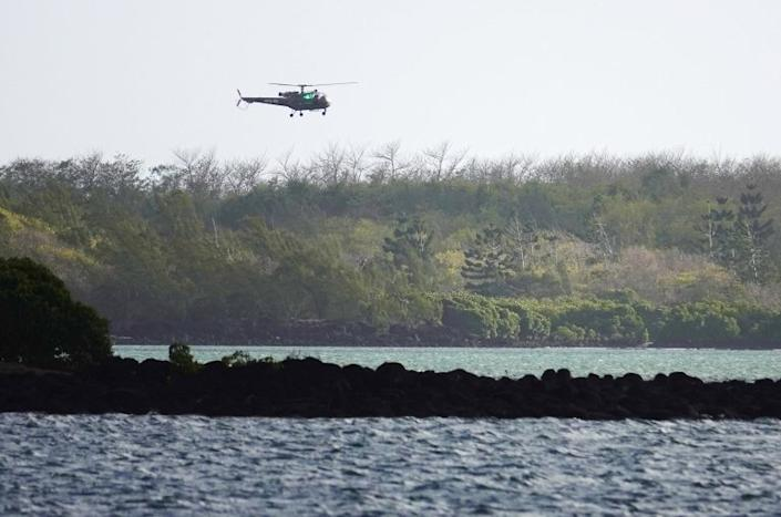 Search and rescue teams, along with fishermen, are combing the area for the missing crew member