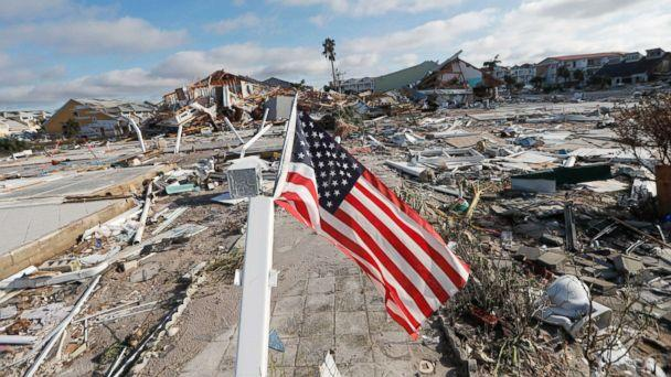 PHOTO: An American flag flies amidst destruction in the aftermath of Hurricane Michael in Mexico Beach, Fla., Oct. 11, 2018. (Gerald Herbert/AP)