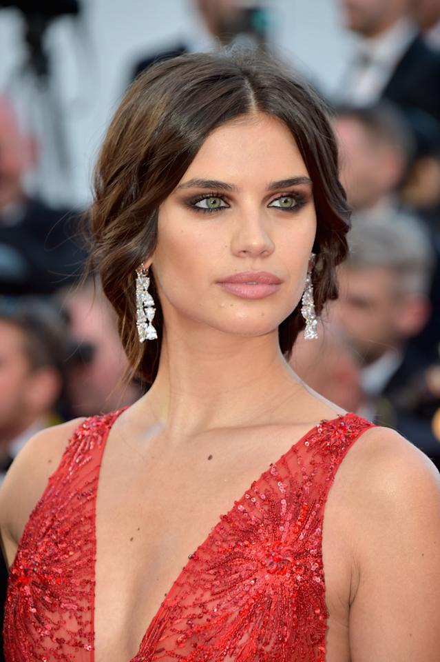 <p>The eyes have it! The Victoria's Secret model attended the <em>Ismael's Ghosts</em> screening at the Cannes Film Festival with red smoky eye makeup, peachy-pink lipstick, and a loose braid that cascaded down her back. (Photo Getty Images) </p>