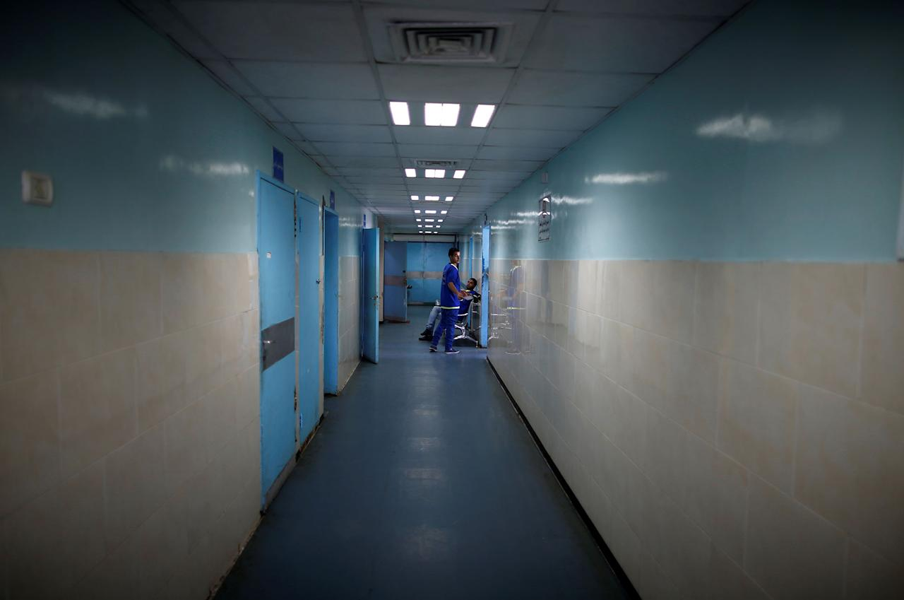 <p>A worker stands in a corridor at Shifa hospital, Gaza's largest public medical facility, in Gaza City, March 29, 2017. (Photo: Mohammed Salem/Reuters) </p>