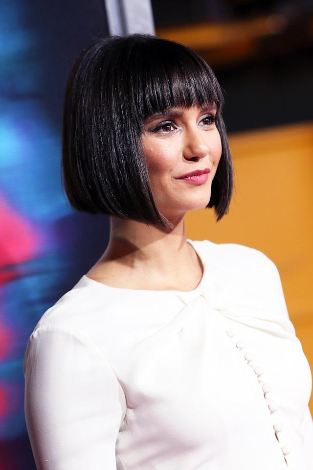 "<p>The actress debuted her ""Nob"" haircut at the Los Angeles premiere of <i>Flatliners. </i>Slate gray eyeshadow, rosy cheeks, and lips added to Dobrev's grown-up look. (Photo: David Livingston/Getty Images) </p>"