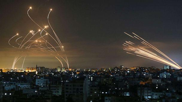 PHOTO: Rockets fired towards Israel from Beit Lahia in the northern Gaza Strip, light up the night sky, May 14, 2021. (Anas Baba/AFP via Getty Images)