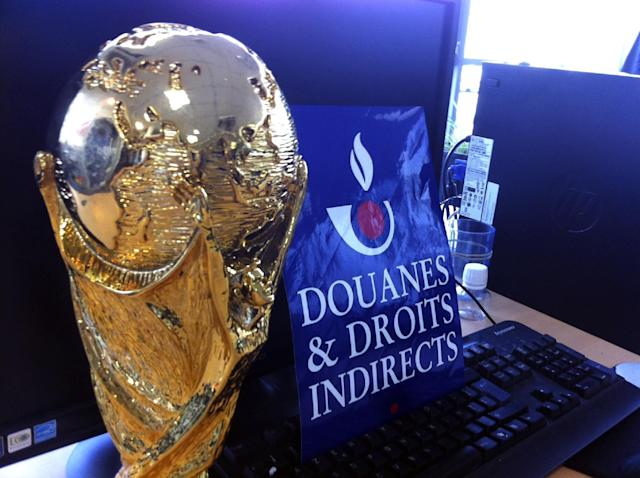 This photo taken on June 18, 2014 and provided Wednesday June 25, 2014 by the French Customs shows a World Cup counterfeit trophy replica seized at Roissy airport, north of Paris. The 30 trophies were coming from China for the domestic market. (AP Photo/Douane Francaise)