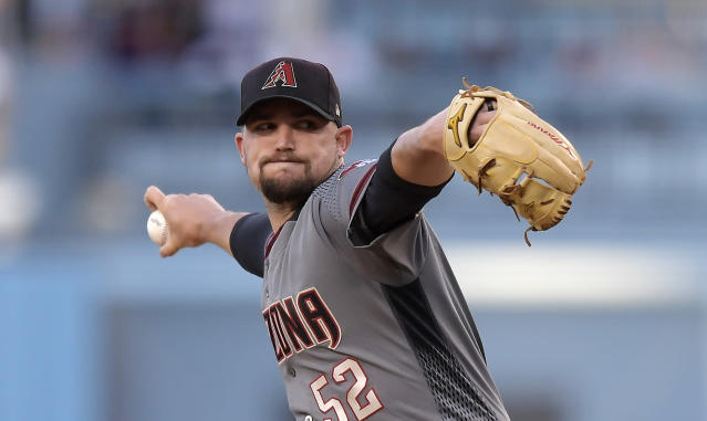 Arizona Diamondbacks starting pitcher Zack Godley throws during the first inning of the team's baseball game against the Los Angeles Dodgers on Saturday, March 30, 2019, in Los Angeles. (AP Photo/Mark J. Terrill)