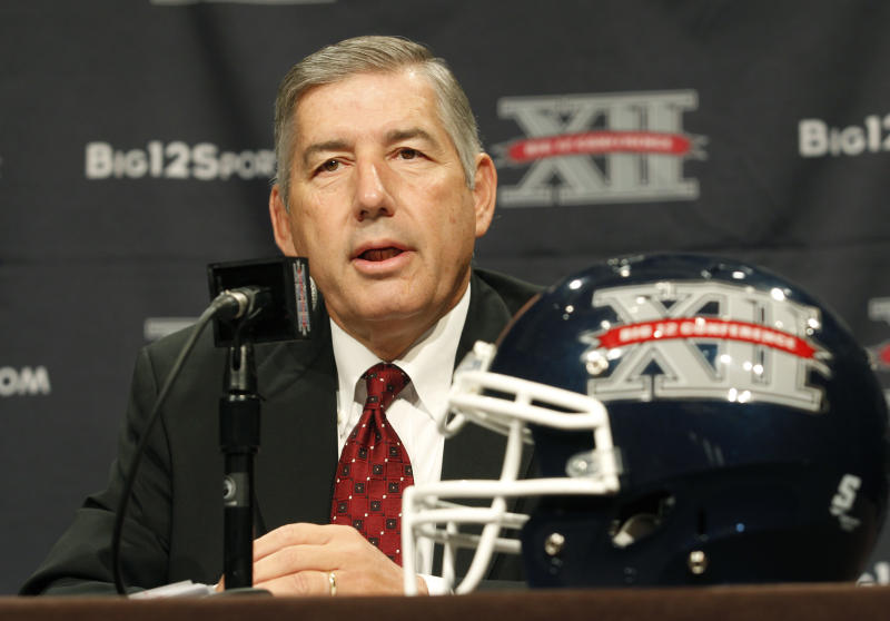 Big 12 Conference Commissioner Bob Bowlsby addresses the media at the beginning of the Big 12 Conference Football Media Days, Monday, July 22, 2013 in Dallas. (AP Photo/Tim Sharp)