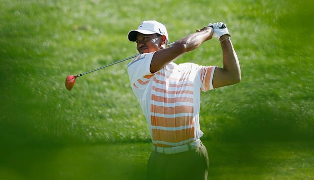 DUBLIN, OH - MAY 31: Tiger Woods hits his approach shot on the 11th hole during the second round of the Memorial Tournament presented by Nationwide Insurance at Muirfield Village Golf Club on May 31, 2013 in Dublin, Ohio. (Photo by Scott Halleran/Getty Images)