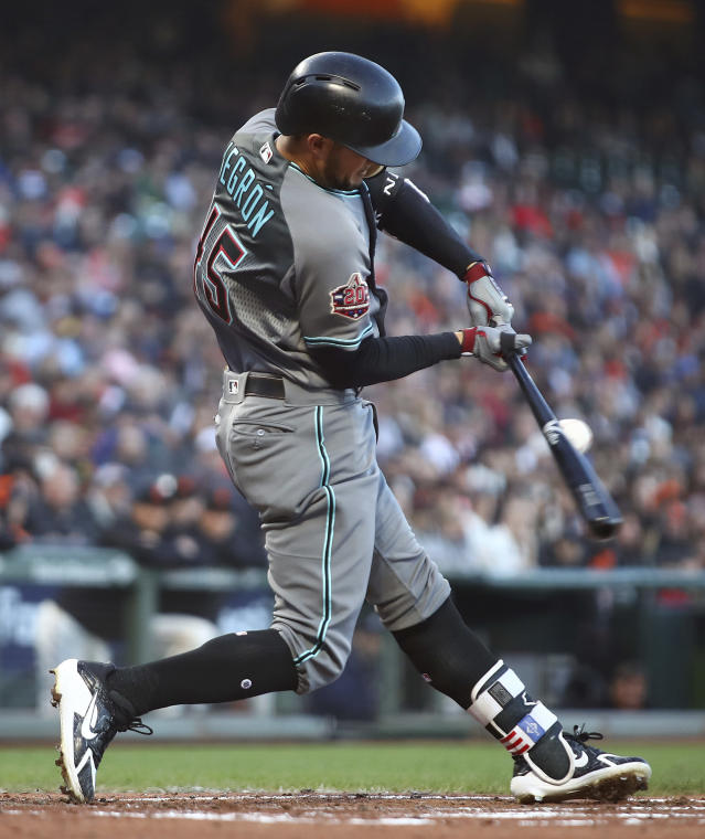 Arizona Diamondbacks' Kristopher Negron connects for an RBI single off San Francisco Giants' Madison Bumgarner during the second inning of a baseball game Tuesday, June 5, 2018, in San Francisco. (AP Photo/Ben Margot)